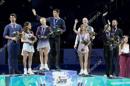 The pairs team of Alexa Knierim and Chris Knierim were crowned champions, second from left, joining them on the podium taking second place, Jessica Calalang and Brian Johnson, third place finishers, third from left Tarah Kayne and Danny OShea with fourth place finishers Ashley Cain-Gribble and Timothy LeDuc, far right, at the 2020 Toyota U.S. Figure Skating Championships, in Greensboro, N.C
