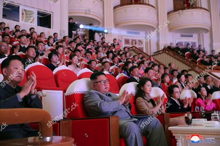 "Stock Picture of Provided by the North Korean government, North Korean leader Kim Jong Un, center, claps with his wife Ri Sol Ju, third from right, and his aunt Kim Kyong Hui, second from right, as they attend a concert celebrating Lunar New Year's Day in Pyongyang, North Korea. Independent journalists were not given access to cover the event depicted in this image distributed by the North Korean government. The content of this image is as provided and cannot be independently verified. Korean language watermark on image as provided by source reads: ""KCNA"" which is the abbreviation for Korean Central News Agency"