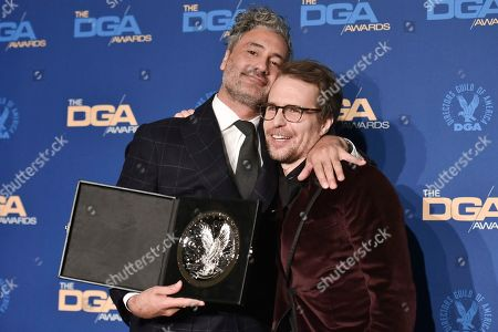 Taika Waititi, Sam Rockwell. Taika Waititi, left, and Sam Rockwelll pose in the press room at the 72nd Annual Directors Guild of America Awards at the Ritz-Carlton Hotel, in Los Angeles