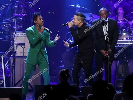 Stock Image of Miguel, Andy Vargas, Wyclef Jean. Miguel, from left, Andy Vargas, and Wyclef Jean perform on stage at the Pre-Grammy Gala And Salute To Industry Icons at the Beverly Hilton Hotel, in Beverly Hills, Calif