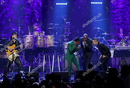 Santana, Miguel, Andy Vargas, Wyclef Jean. Santana, from left, Miguel, Andy Vargas, and Wyclef Jean perform on stage at the Pre-Grammy Gala And Salute To Industry Icons at the Beverly Hilton Hotel, in Beverly Hills, Calif