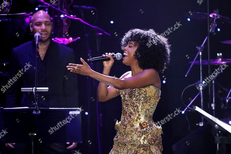 Adrienne Warren performs on stage at the Pre-Grammy Gala And Salute To Industry Icons at the Beverly Hilton Hotel, in Beverly Hills, Calif