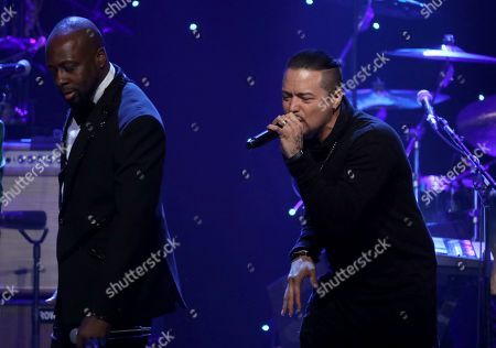 Stock Picture of Wyclef Jean, Andy Vargas. Wyclef Jean, left, and Andy Vargas perform on stage at the Pre-Grammy Gala And Salute To Industry Icons at the Beverly Hilton Hotel, in Beverly Hills, Calif