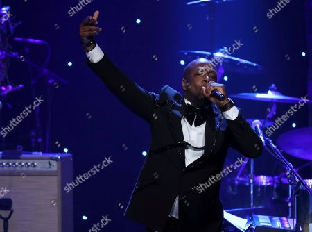 Wyclef Jean performs on stage at the Pre-Grammy Gala And Salute To Industry Icons at the Beverly Hilton Hotel, in Beverly Hills, Calif