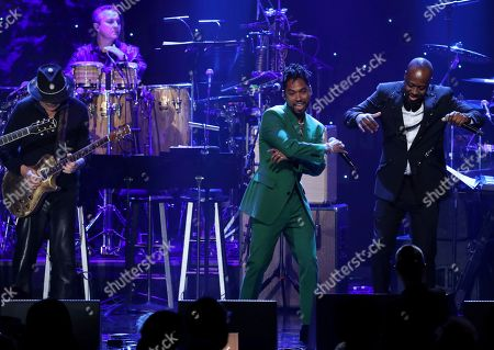 Santana, Miguel, Wyclef Jean. Santana, from left, Miguel, and Wyclef Jean perform on stage at the Pre-Grammy Gala And Salute To Industry Icons at the Beverly Hilton Hotel, in Beverly Hills, Calif