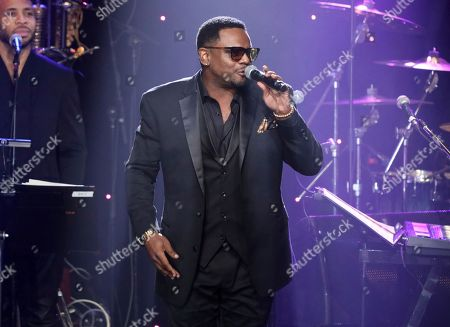 Carl Thomas performs on stage at the Pre-Grammy Gala And Salute To Industry Icons at the Beverly Hilton Hotel, in Beverly Hills, Calif