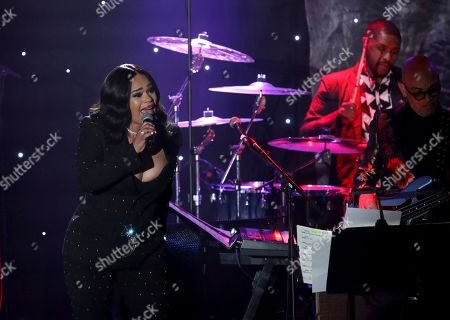 Faith Evans performs on stage at the Pre-Grammy Gala And Salute To Industry Icons at the Beverly Hilton Hotel, in Beverly Hills, Calif