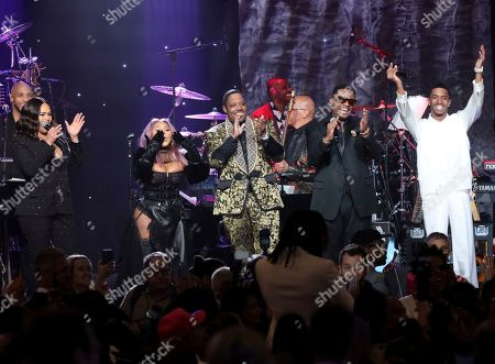 Faith Evans, Lil' Kim, Mase, Carl Thomas, Christian Casey Combs. Faith Evans, from left, Lil' Kim, Mase, Carl Thomas, and Christian Casey Combs perform on stage at the Pre-Grammy Gala And Salute To Industry Icons at the Beverly Hilton Hotel, in Beverly Hills, Calif