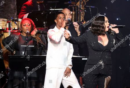 Christian Casey Combs, Faith Evans. Christian Casey Combs, left, and Faith Evans perform on stage at the Pre-Grammy Gala And Salute To Industry Icons at the Beverly Hilton Hotel, in Beverly Hills, Calif