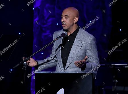 Harvey Mason Jr. speaks on stage at the Pre-Grammy Gala And Salute To Industry Icons at the Beverly Hilton Hotel, in Beverly Hills, Calif