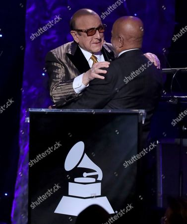 Clive Davis, Berry Gordy. Clive Davis, left, embraces Berry Gordy on stage at the Pre-Grammy Gala And Salute To Industry Icons at the Beverly Hilton Hotel, in Beverly Hills, Calif