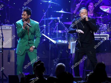 Miguel, Andy Vargas. Miguel, left, and Andy arias perform on stage at the Pre-Grammy Gala And Salute To Industry Icons at the Beverly Hilton Hotel, in Beverly Hills, Calif