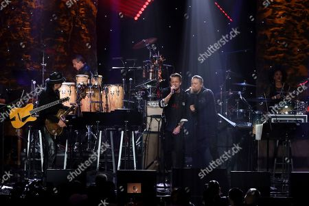 Santana, Rob Thomas, Andy Vargas. Santana, from left, Rob Thomas, and Andy Vargas perform on stage at the Pre-Grammy Gala And Salute To Industry Icons at the Beverly Hilton Hotel, in Beverly Hills, Calif