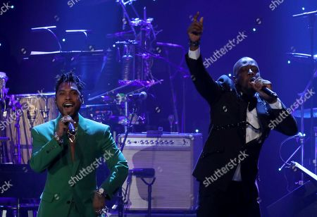 Miguel, Wyclef Jean. Miguel, left, and Wyclef Jean perform on stage at the Pre-Grammy Gala And Salute To Industry Icons at the Beverly Hilton Hotel, in Beverly Hills, Calif