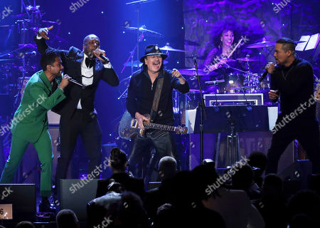 Miguel, Wyclef Jean, Santana, Andy Vargas. Miguel, from left, Wyclef Jean, Santana, and Andy Vargas perform on stage at the Pre-Grammy Gala And Salute To Industry Icons at the Beverly Hilton Hotel, in Beverly Hills, Calif