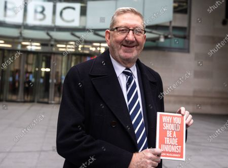 Len McCluskey, Unite General Secretary, leaves after appearing on 'The Andrew Marr Show' and holds up his book 'Why you should be a Trade Unionist'.