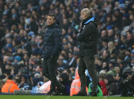 Fulham manager Scott Parker and Manchester City manager Pep Guardiola chating during the The FA Cup match between Manchester City and Fulham at the Etihad Stadium, Manchester