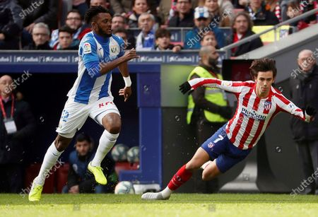 Atletico Madrid's Joao Felix (R) and Chidozie Awaziem (L) of CD Leganes in action during the Spanish LaLiga soccer match between Atletico Madrid and CD Leganes in Madrid, Spain, 26 January 2020.