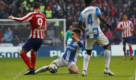 Atletico Madrid's Alvaro Morata (L), Kenneth Omeruo (R) and Unai Bustinza (C) of CD Leganes in action during the Spanish LaLiga soccer match between Atletico Madrid and CD Leganes in Madrid, Spain, 26 January 2020.