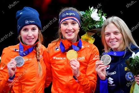 Suzanne Schulting (C) of the Netherlands poses with her gold medal on the podium after winning the women's 1,000m final of the ISU European Short Track Speed Skating Championships in Debrecen, Hungary, 26 January 2020. Schulting won ahead of her second placed compatriot Lara van Ruijven (L) and third placed Arianna Fontana (R) of Italy.