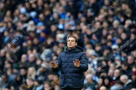 Fulham head coach Scott Parker gestures during an English FA Cup fourth round soccer match between Manchester City and Fulham at the Etihad Stadium in Manchester, England