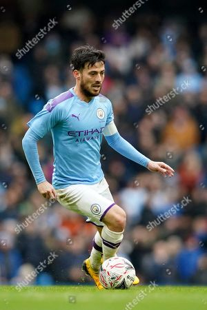 Stock Image of Manchester City's David Silva runs with the ball during an English FA Cup fourth round soccer match between Manchester City and Fulham at the Etihad Stadium in Manchester, England