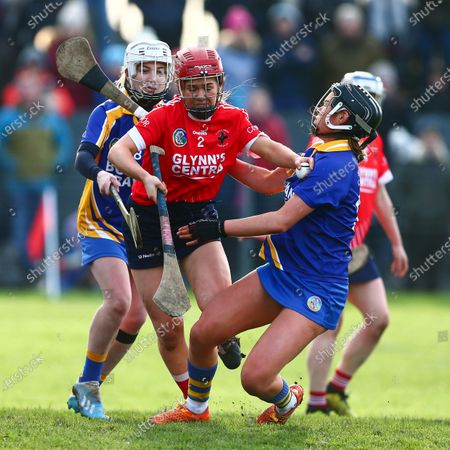 Stock Image of Carnmore vs St. Rynagh's. Carnmore's Jessica Donlon with St. Rynagh's Helen Dolan and Kate Kenny