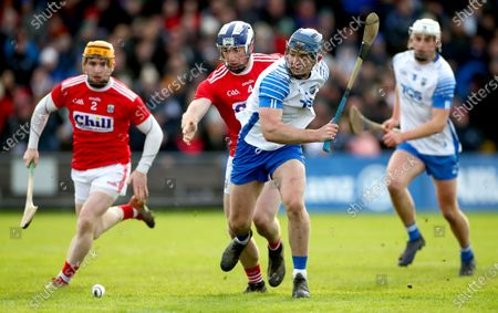 Waterford vs Cork. Cork's Niall O'Leary and Sean O'Donoghue tackle Patrick Curran of Waterford