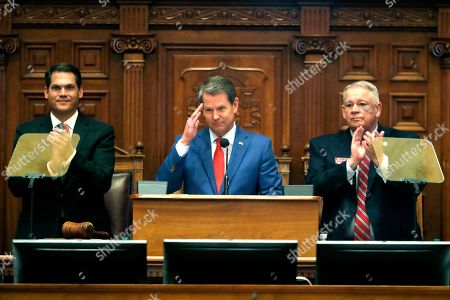 Brian Kemp, Geoff Duncan, David Ralston. Gov. Brian Kemp, center, is flanked by House Speaker David Ralston, R-Blue Ridge, right, and Lt. Gov. Geoff Duncan as he salutes former U.S. Senator Johnny Isakson, R-Ga., during the State of the State address before a joint session of the Georgia General Assembly in Atlanta. Kemp is proposing that Georgia borrow almost $900 million for construction projects and equipment next year. Key projects in the Republican governor's borrowing plan include $70 million to expand the state-owned convention center in Savannah and $55 million to build a new headquarters for the Department of Public Safety in Atlanta