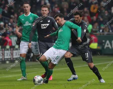 Stock Image of Bremen's Nuri Sahin (2-L) in action against Hoffenheim's Florian Grillitsch (R) during the German Bundesliga soccer match between SV Werder Bremen and TSG 1899 Hoffenheim's in Bremen, Germany, 26 January 2020.