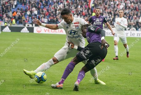 Rafael Da Silva, Issiaga Sylla. Lyon's Rafael Da Silva, left, and Toulouse's Issiaga Sylla challenge for the ball during the French League One soccer match between Lyon and Toulouse in Decines, outside Lyon, central France