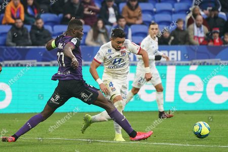 Jean-Victor Makengo, Rafael Da Silva. Lyon's Rafael Da Silva, center, and Toulouse's Jean-Victor Makengo challenge for the ball during the French League One soccer match between Lyon and Toulouse in Decines, outside Lyon, central France