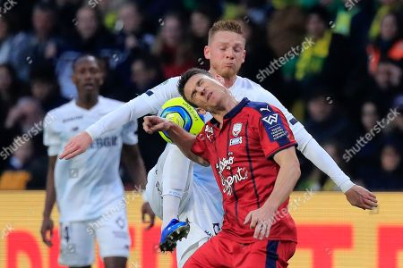 Nantes Renaud Emond, background, fights for the ball with Bordeaux's Laurent Koscielny during the French League One soccer match between Nantes and Bordeaux at La Beaujoire stadium in Nantes, western France