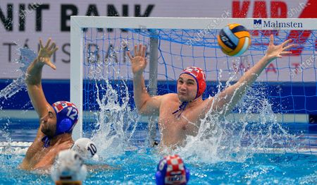 Goalie Ivan Marcelic (R) and Javier Garcia (L) of Croatia try to block a shot during men's European Water Polo Championship match Montenegro vs. Croatia for the bronze medal in Budapest, Hungary, 26 January 2020.