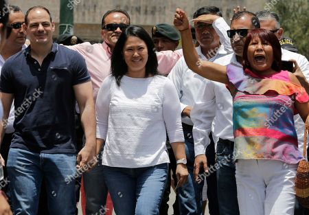 Keiko Fijimori, Mark Vito Villanela. Keiko Fujimori, the daughter of Peru's former President Alberto Fujimori, and leader of the opposition party, center, with her husband Mark Vito Villanela, left, arrive to vote during congressional elections in Lima, Peru, . Peruvians are voting to elect 130 new members of the congress that will legislate for only one year in place of the congress that was dissolved by president Martin Vizacarra in September 2019