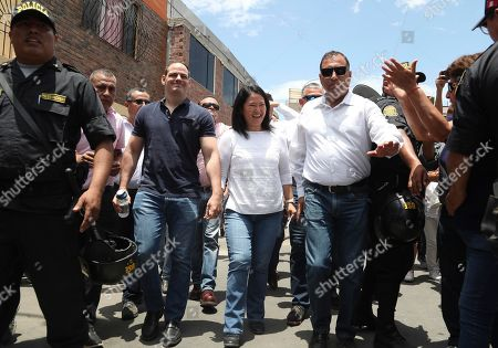 Keiko Fujimori, Mark Vito Villanela. Keiko Fujimori, the daughter of Peru's former President Alberto Fujimori, and leader of the opposition party, center, with her husband Mark Vito Villanela, left, arrive to vote during congressional elections in Lima, Peru, . Peruvians are voting to elect 130 new members of the congress that will legislate for only one year in place of the congress that was dissolved by president Martin Vizacarra in September 2019