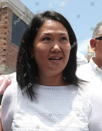 Keiko Fujimori, the daughter of Peru's former President Alberto Fujimori, and leader of the opposition party, arrive to vote during congressional elections in Lima, Peru, . Peruvians are voting to elect 130 new members of the congress that will legislate for only one year in place of the congress that was dissolved by president Martin Vizacarra in September 2019