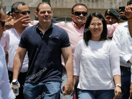 Keiko Fujimori, Mark Vito Villanela. Keiko Fujimori, the daughter of Peru's former President Alberto Fujimori, and leader of the opposition party, with her husband Mark Vito Villanela, left, arrive to vote during congressional elections in Lima, Peru, . Peruvians are voting to elect 130 new members of the congress that will legislate for only one year in place of the congress that was dissolved by president Martin Vizacarra in September 2019