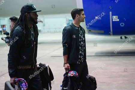 San Francisco 49ers' Jimmy Garoppolo and Richard Sherman arrive for the NFL Super Bowl 54 football game, at the Miami International Airport in Miami