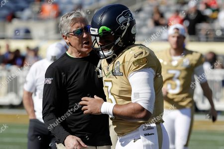 Pete Carroll, Russell Wilson. NFC head coach Pete Carroll, of the Seattle Seahawks, left, talks to quarterback Russell Wilson, of the Seattle Seahawks, (3), before the NFL Pro Bowl football game, in Orlando, Fla