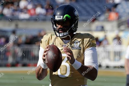 Stock Picture of NFC quarterback Russell Wilson, of the Seattle Seahawks, warms up before the NFL Pro Bowl football game, in Orlando, Fla