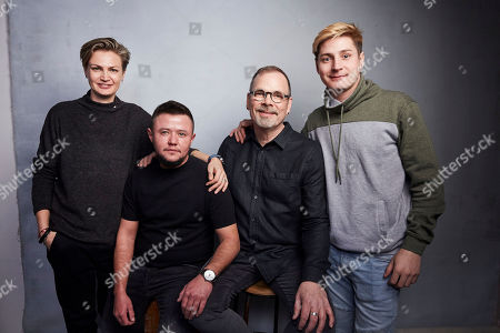 """Olga Baranova, David Isteev, David France, Maxim Lapunov. Olga Baranova, from left, David Isteev, director David France, and Maxim Lapunov pose for a portrait to promote the film """"Welcome to Chechnya"""" at the Music Lodge during the Sundance Film Festival, in Park City, Utah"""