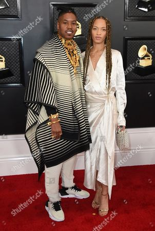 Christian Scott aTunde Adjuah, Devan Mayfield. Christian Scott aTunde Adjuah, left, and Devan Mayfield arrive at the 62nd annual Grammy Awards at the Staples Center, in Los Angeles