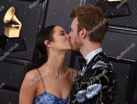 Claudia Sulewski, Finneas O'Connell. Claudia Sulewski, left, and Finneas O'Connell kiss on the red carpet at the 62nd annual Grammy Awards at the Staples Center, in Los Angeles