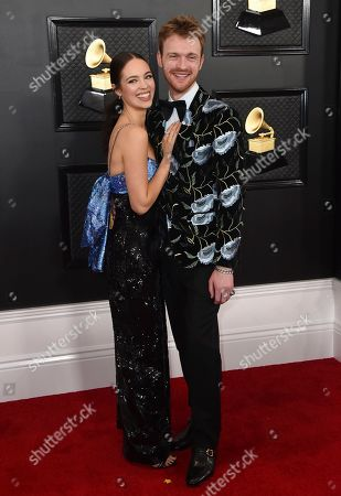 Claudia Sulewski, Finneas O'Connell. Claudia Sulewski, left, and Finneas O'Connell arrive at the 62nd annual Grammy Awards at the Staples Center, in Los Angeles