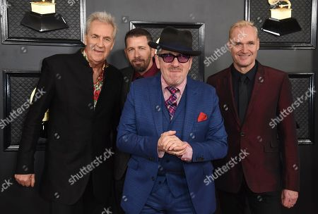 Pete Thomas, Davey Faragher, Elvis Costello, Steve Nieve. Pete Thomas, from left, Steve Nieve, Elvis Costello and Davey Faragher arrive at the 62nd annual Grammy Awards at the Staples Center, in Los Angeles