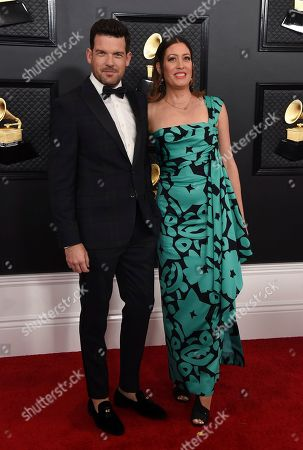 Michelle Kath Sinclair, Adam Sinclair. Adam Sinclair, left, and Michelle Kath Sinclair arrive at the 62nd annual Grammy Awards at the Staples Center, in Los Angeles