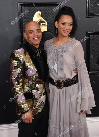 Rickey Minor, Rachel Montez. Rickey Minor, left, and Rachel Montez arrive at the 62nd annual Grammy Awards at the Staples Center, in Los Angeles