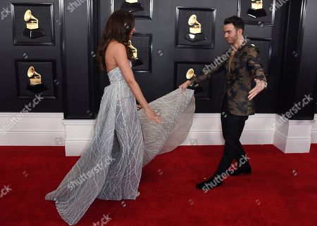 Kevin Jonas, Danielle Deleasa. Danielle Deleasa, left, and Kevin Jonas arrive at the 62nd annual Grammy Awards at the Staples Center, in Los Angeles