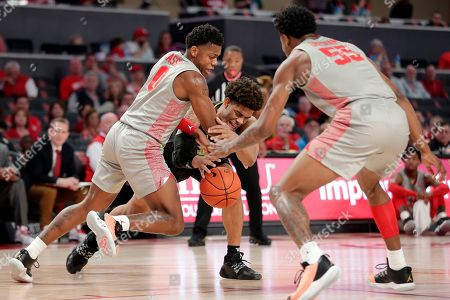 Houston guard Marcus Sasser, left, and South Florida guard David Collins, center, lunge for the ball in front of Houston center Brison Gresham (55) during the first half of an NCAA college basketball game, in Houston